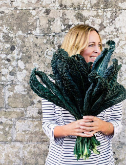 Portrait of Amelia Freer holding kale