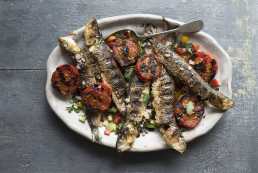 Grilled sardines with roasted tomatoes